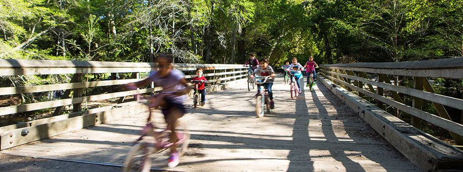 Children playing on the campground bridge
